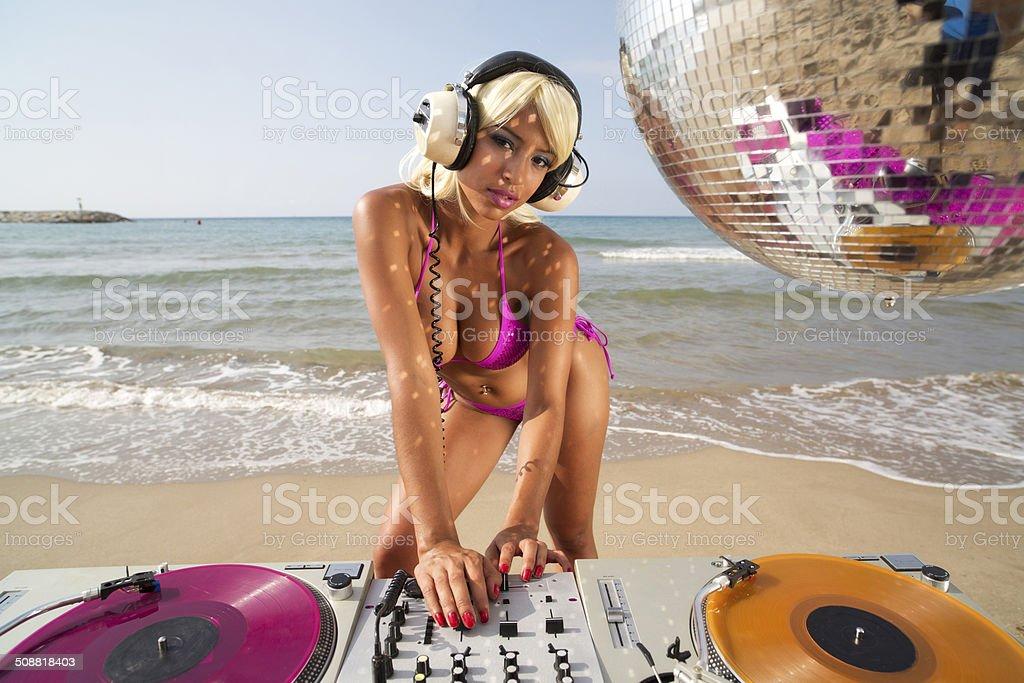 beautiful sexy woman dj at beach stock photo
