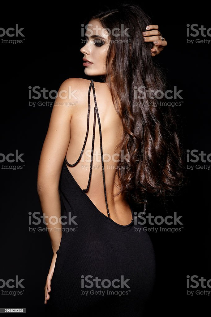 Beautiful sexy woman in black evening dress stock photo