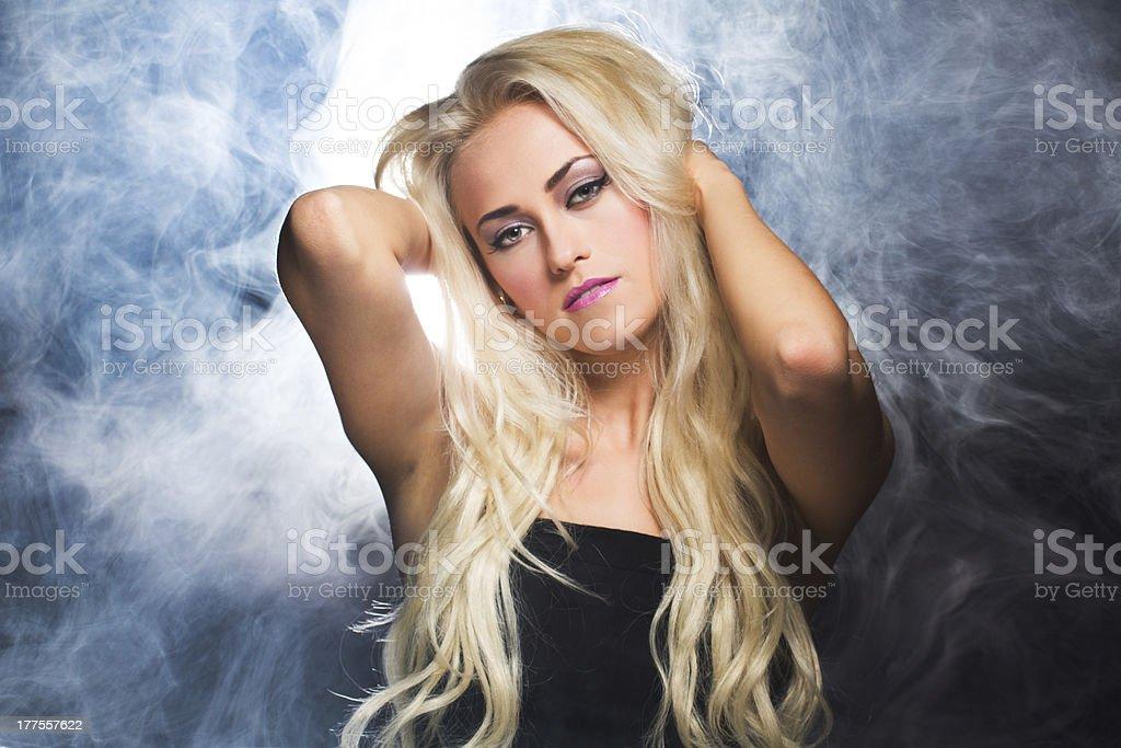Beautiful sexy woman in the smoke royalty-free stock photo