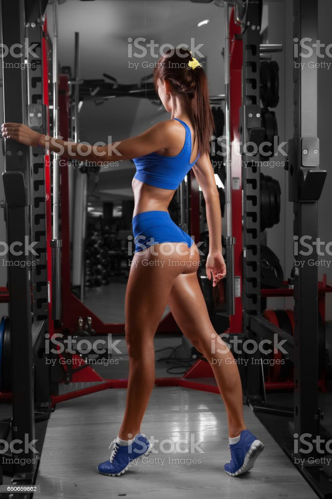 beautiful sexy woman with perfect buttocks at the gym stock photo