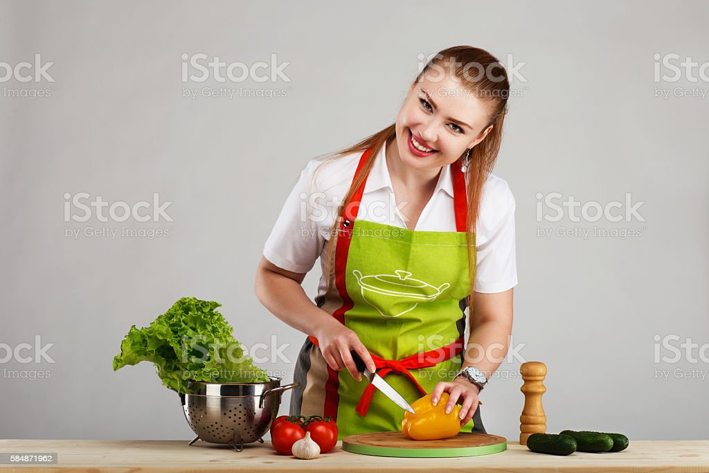 Beautiful sexy young woman cooking fresh meal stock photo
