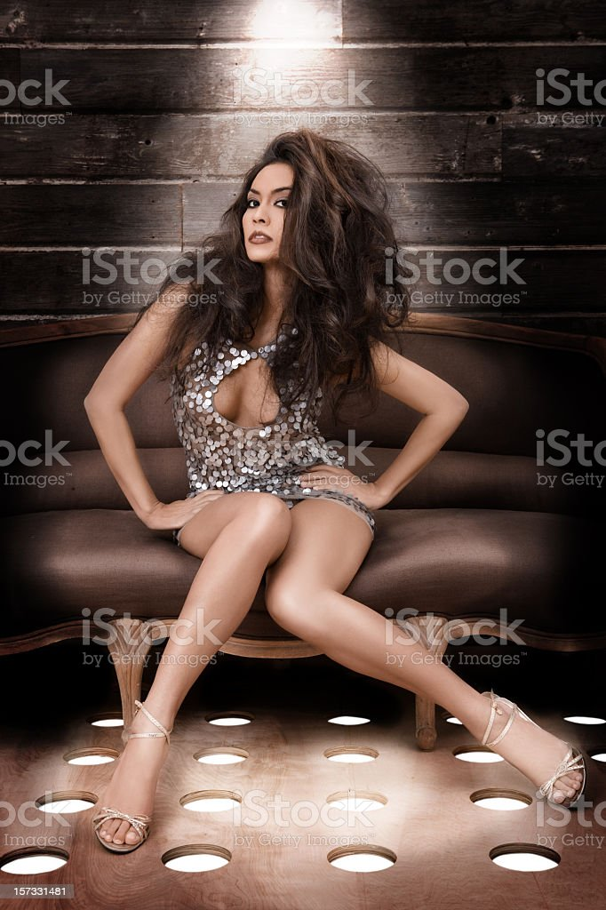 Beautiful Sexy Young Woman in Disco Club with Big Hair stock photo
