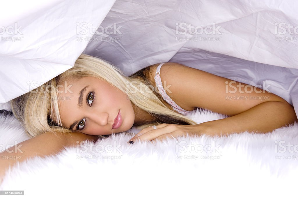 Beautiful, Sexy Young Woman in Lingerie Under White Sheets, Copyspace stock photo