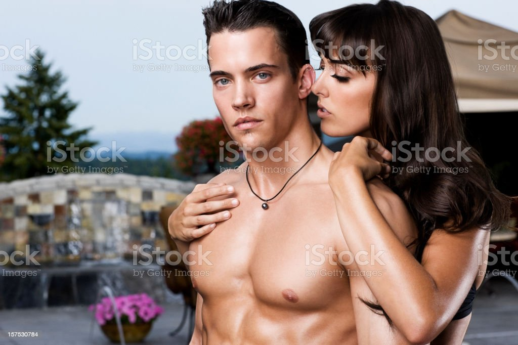 Beautiful Sexy Young Woman Whispering to Shirtless Man, Copy Space royalty-free stock photo
