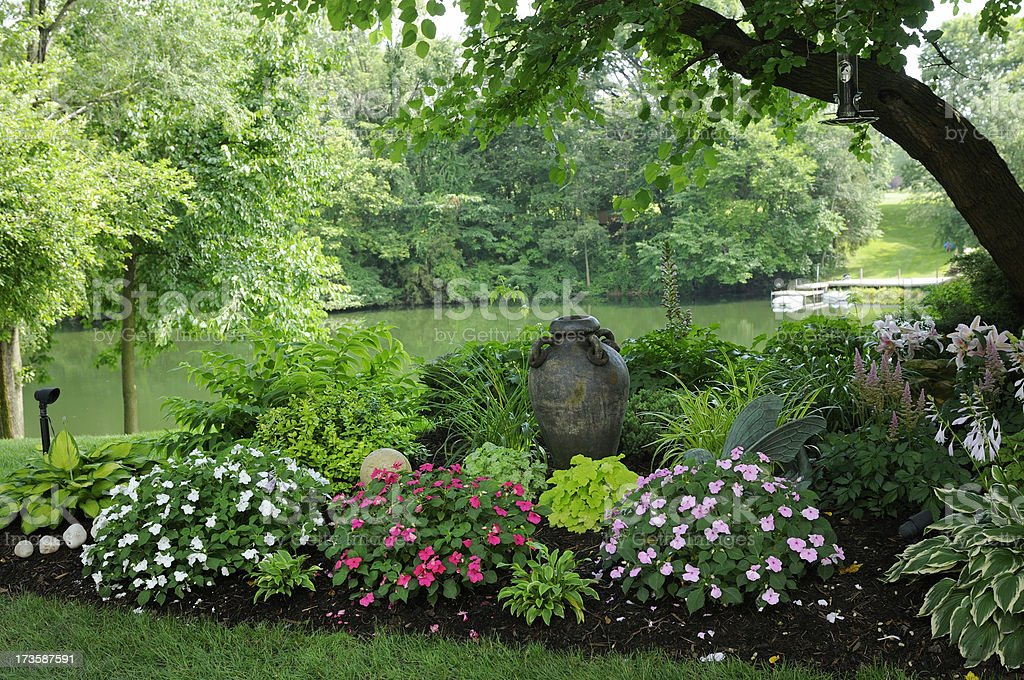 Beautiful Shade Garden by the Water royalty-free stock photo