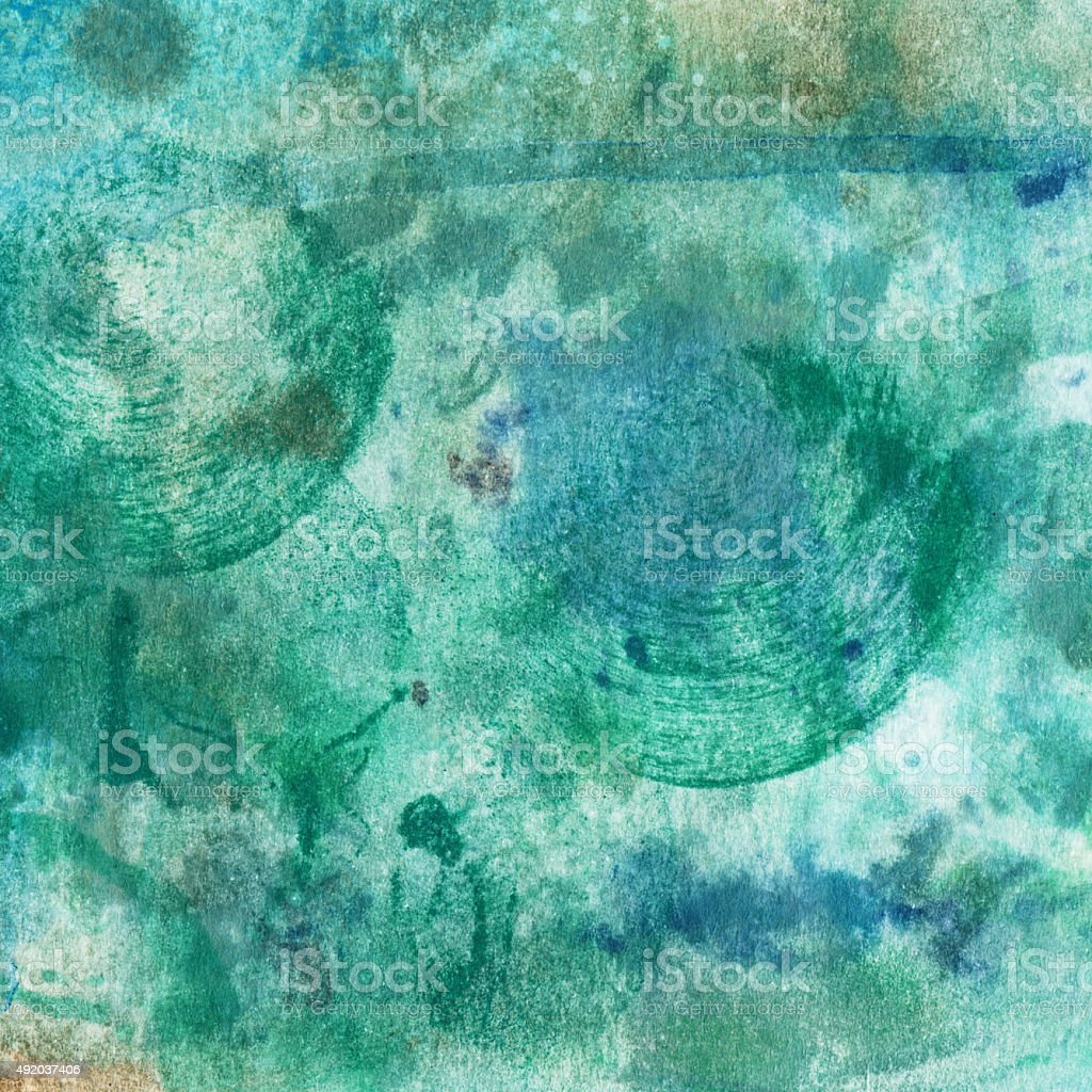 Beautiful shades of green and blue hand painted on paper stock photo