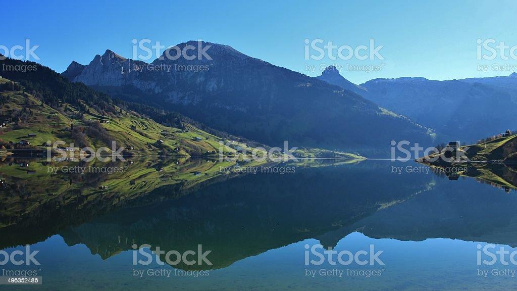Beautiful shaped mountains mirroring in lake Wagital stock photo