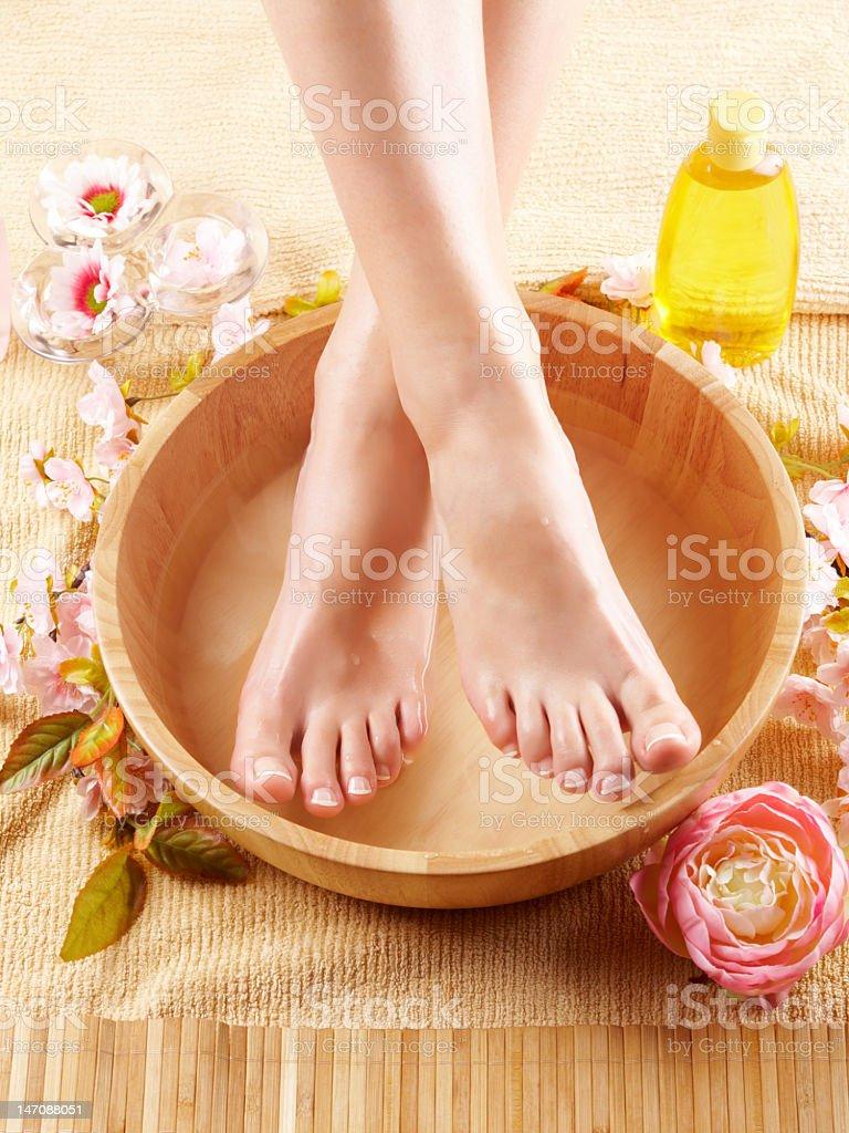Beautiful shiny female like feet stock photo