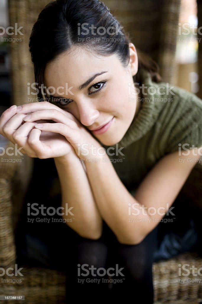Beautiful Shy Young Woman Portrait at Camera in Cafe, Copyspace royalty-free stock photo