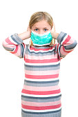 Beautiful sick girl protect flu by the mask for kid.
