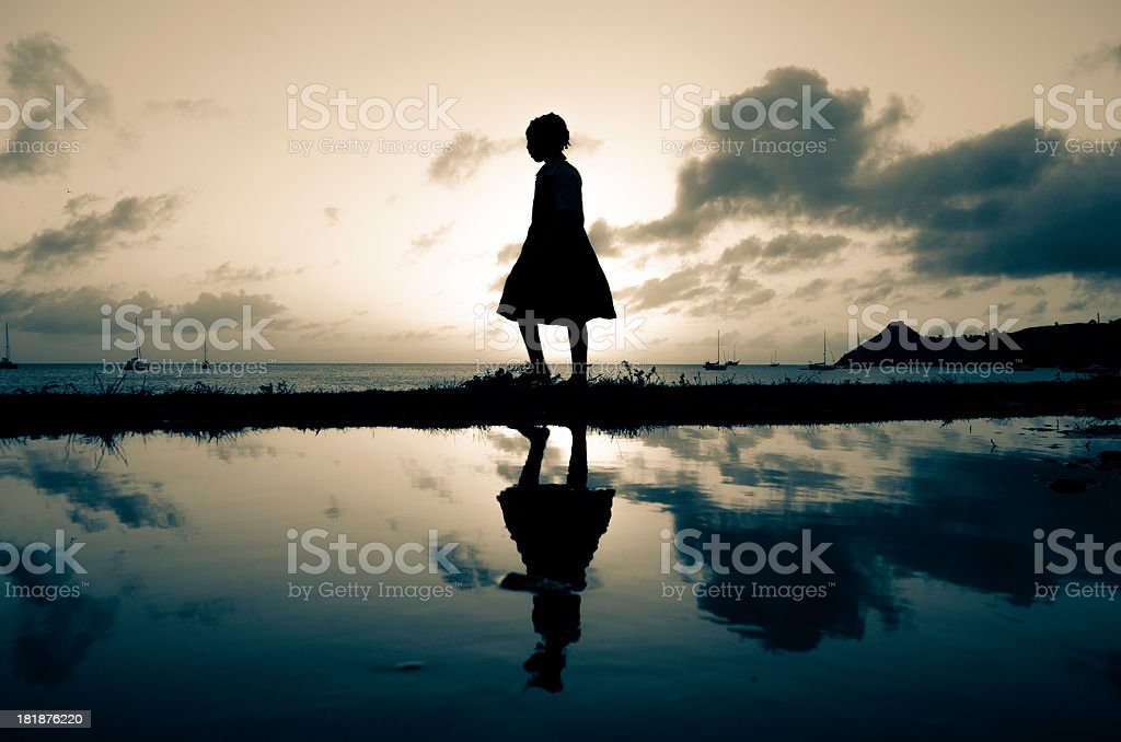 beautiful silhouette of girl at sunset royalty-free stock photo