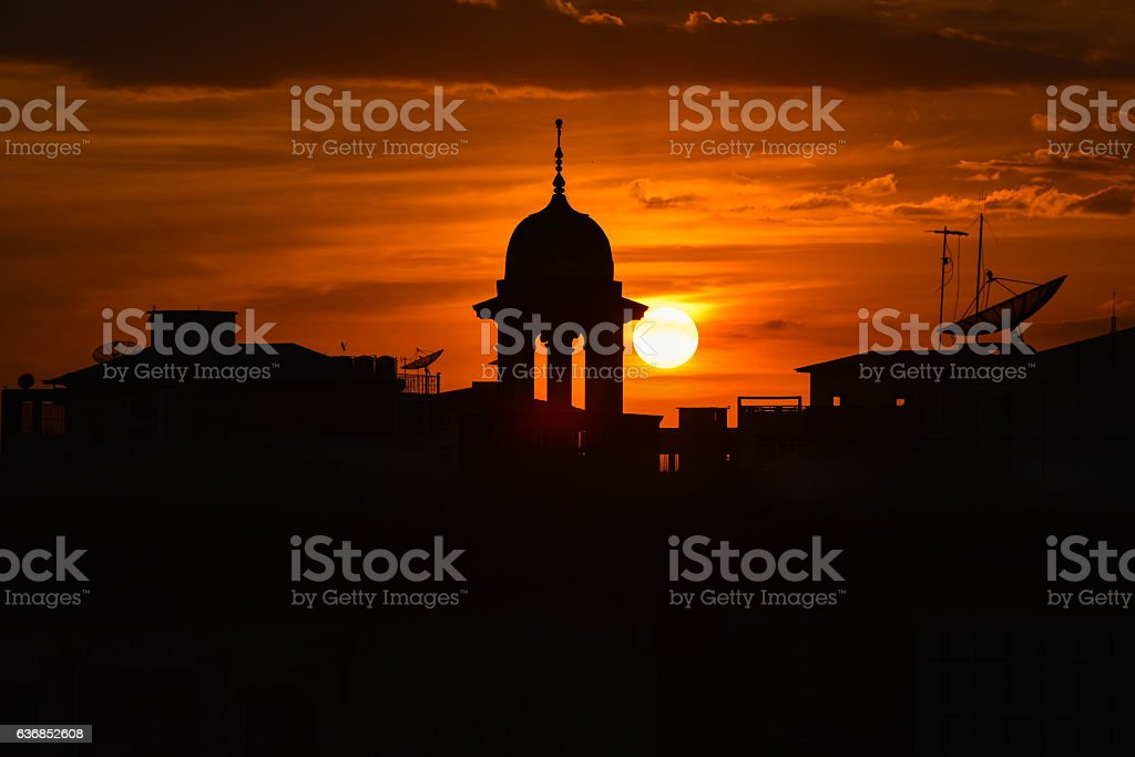 Beautiful Silhouette of Mosque and satellite dish stock photo