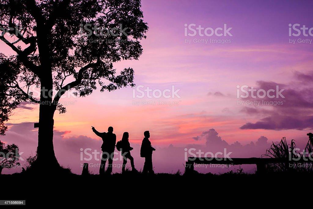 Beautiful silhouette tourist having fun at sunset time royalty-free stock photo