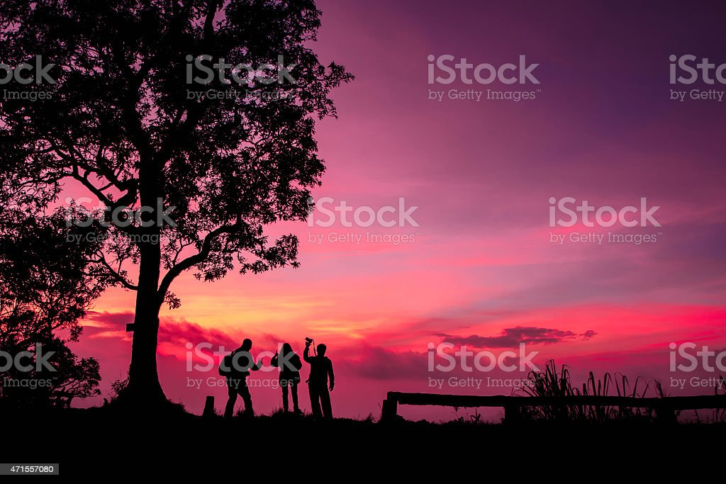Beautiful silhouette tourist having fun at sunset time royalty-free stock photo