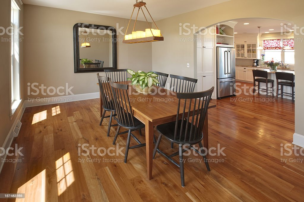 Beautiful Simple Country Style Dining Room, Hardwood Floor, Candle Chandelier stock photo