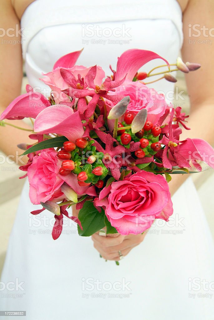 Beautiful Simple Pink Wedding Bouquet Held by the Bride royalty-free stock photo