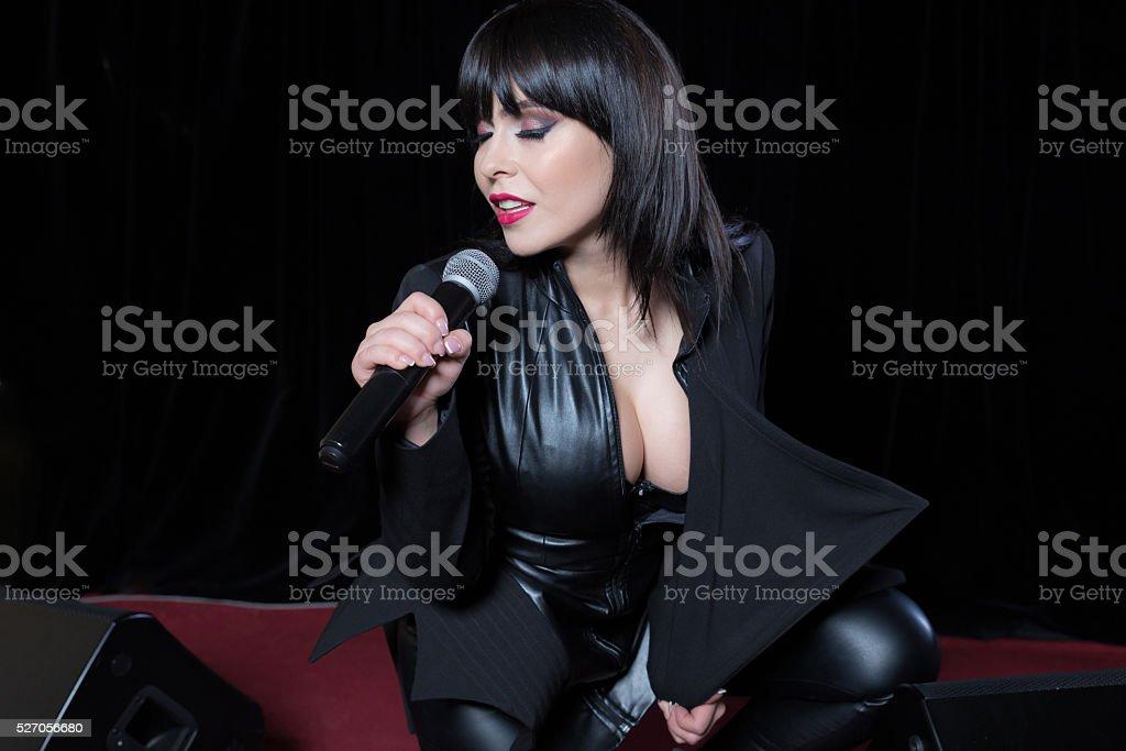 Beautiful singer singing stock photo