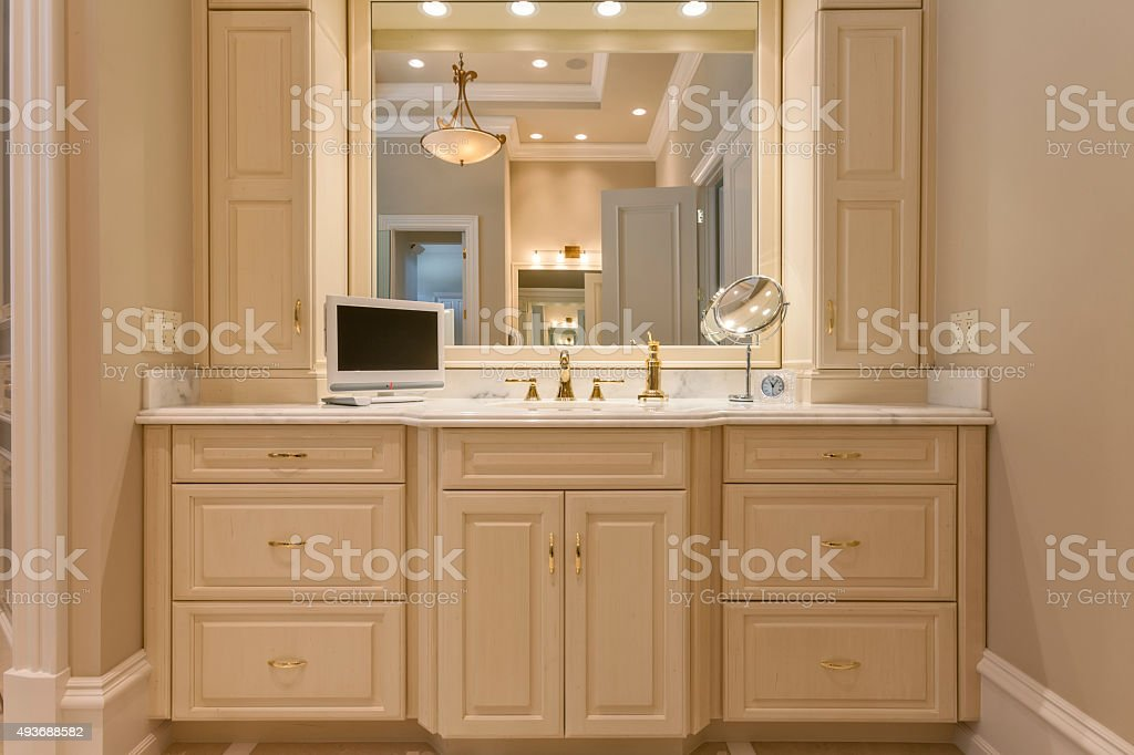 Beautiful Sink Cabinet and Mirror in Bathroom stock photo