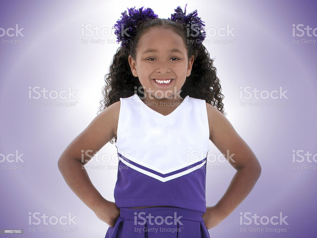 Beautiful Six Year Old Cheerleader Over Purple royalty-free stock photo