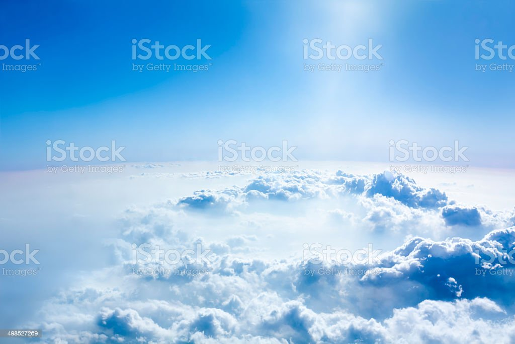 Beautiful sky and above cloud panorama from the airplane. stock photo