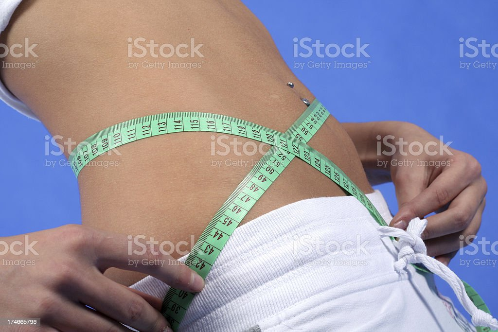 Beautiful Slim Belly - Weight loss royalty-free stock photo