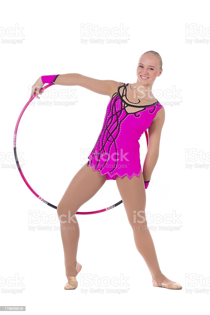 Beautiful slim girl gymnast in costume with a hoop royalty-free stock photo