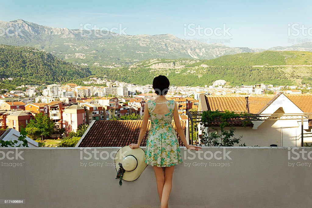 Beautiful slim girl in a short dress and hat stock photo
