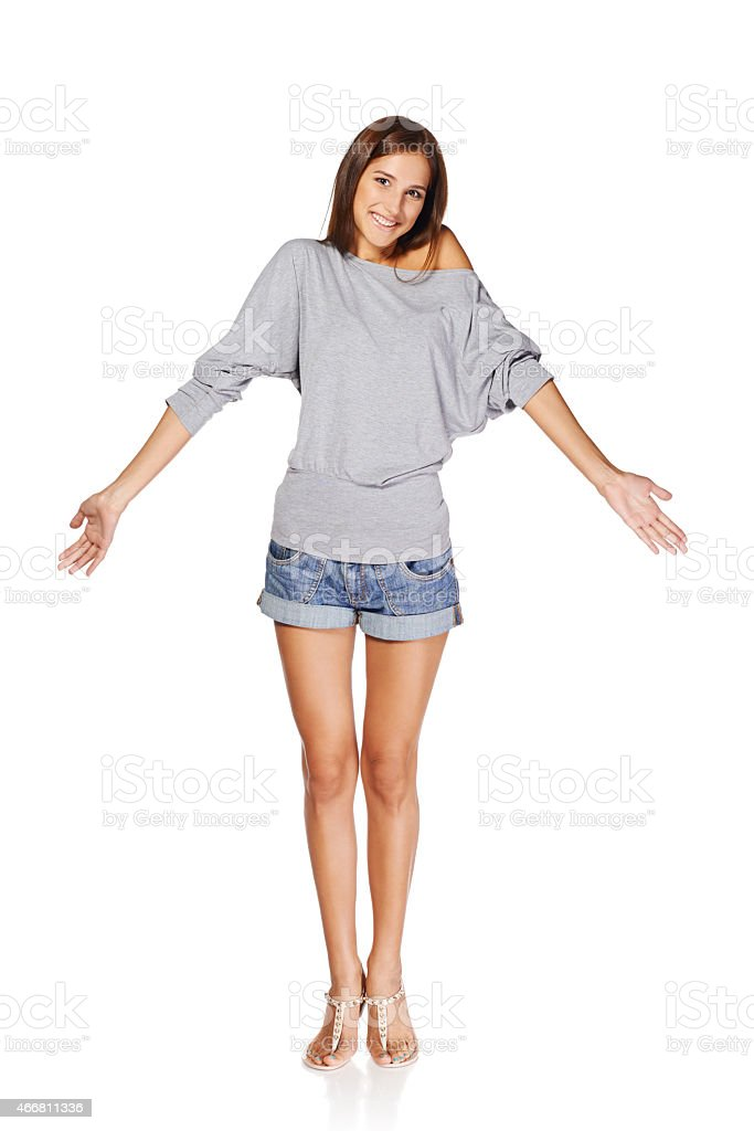 Beautiful slim girl shrugs her shoulders stock photo