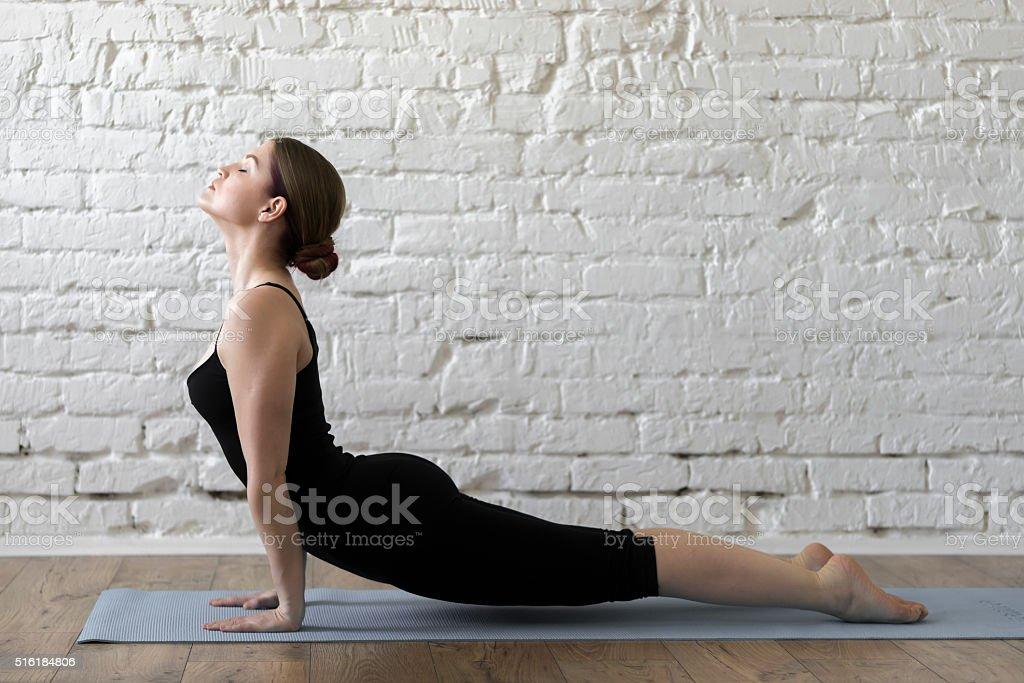 Beautiful slim woman doing yoga stock photo