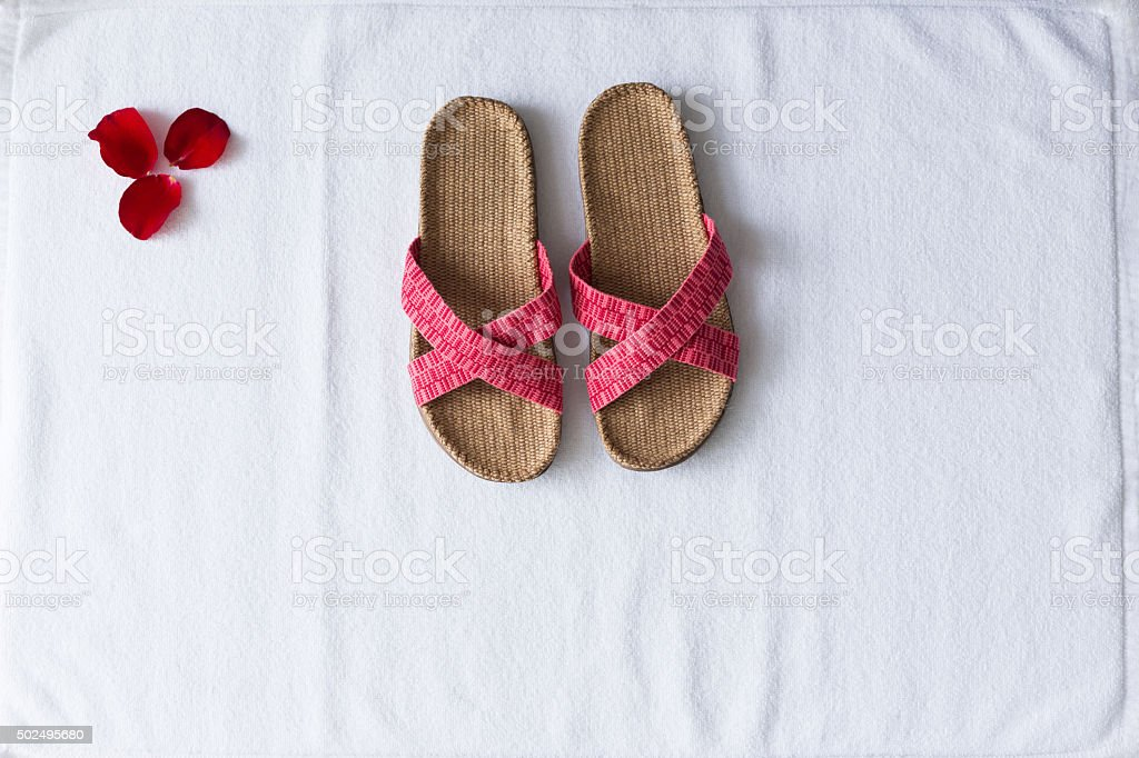 beautiful slippers on white towel stock photo