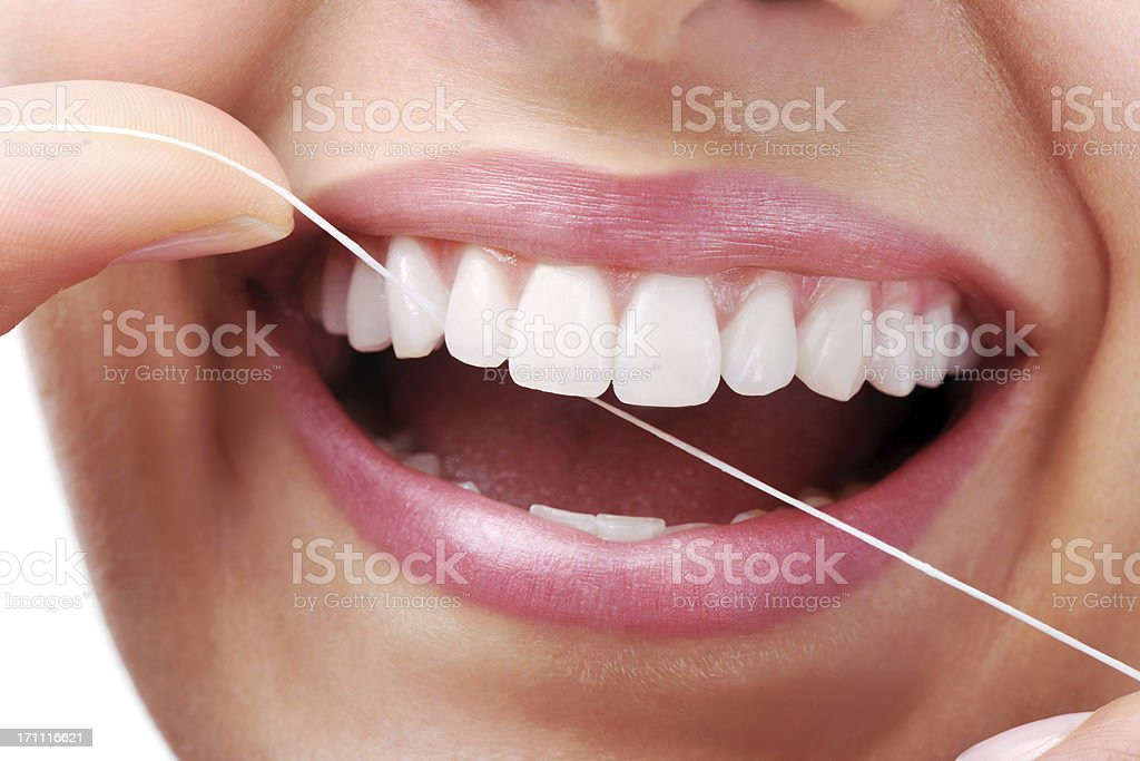 Beautiful Smile With Dental Floss stock photo