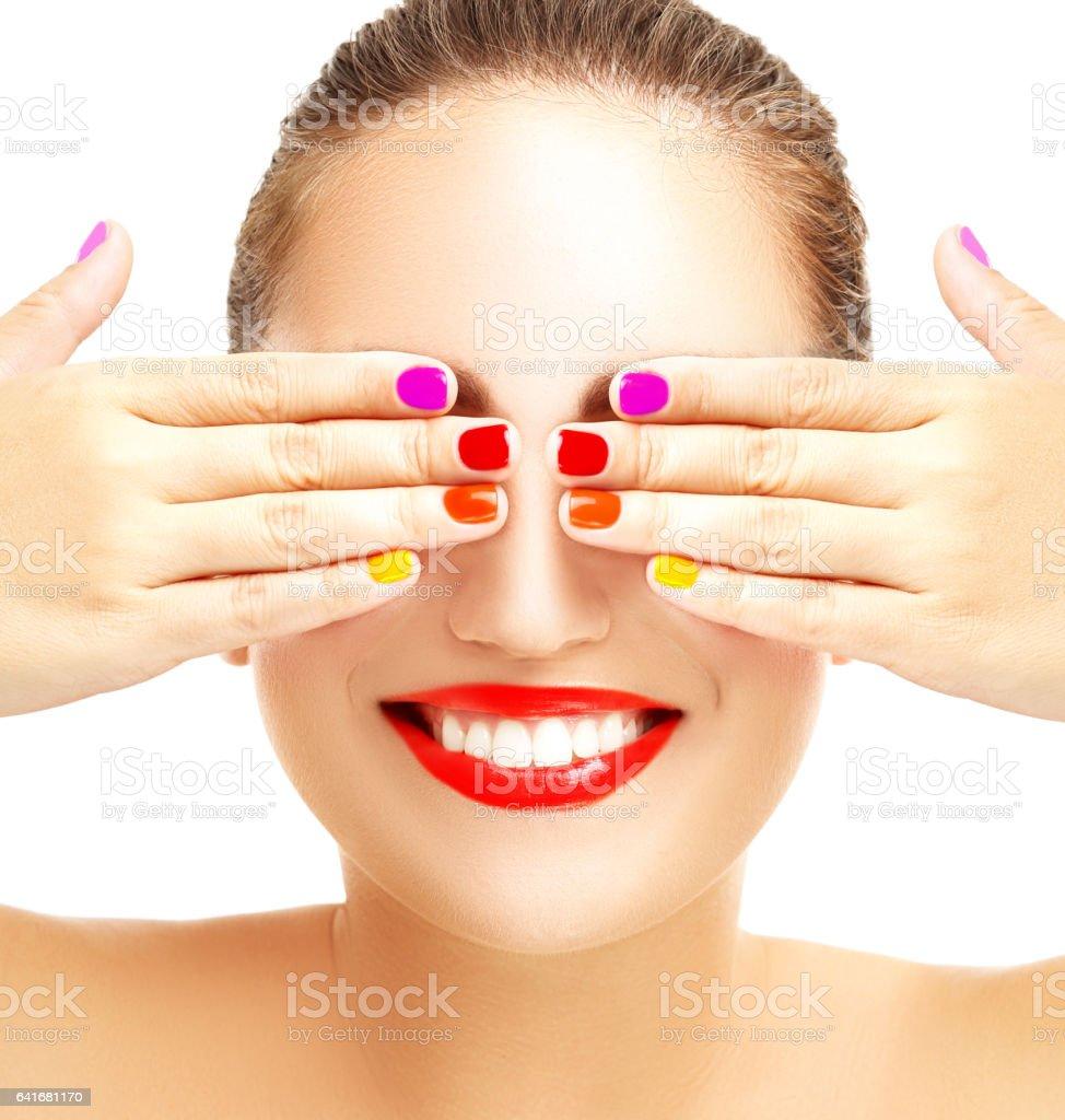 Beautiful smile.Multicolored manicure stock photo