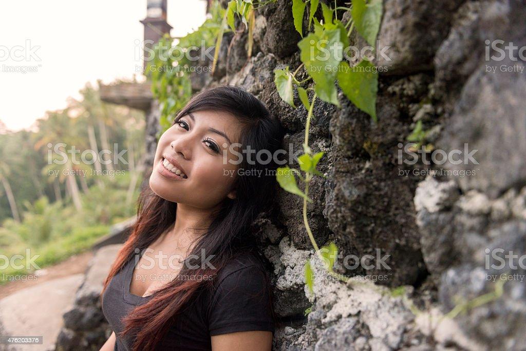 Beautiful Smiling Asian Woman Exploring Ubud Rice Terrace Bali Indonesia stock photo