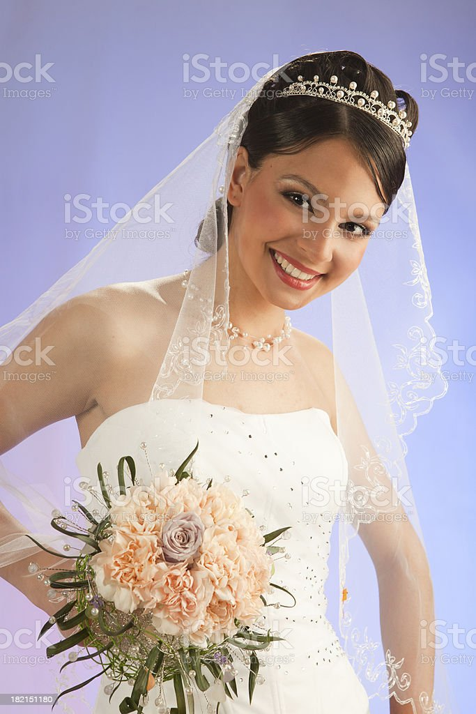 Beautiful smiling bride in the veil with bouquet royalty-free stock photo