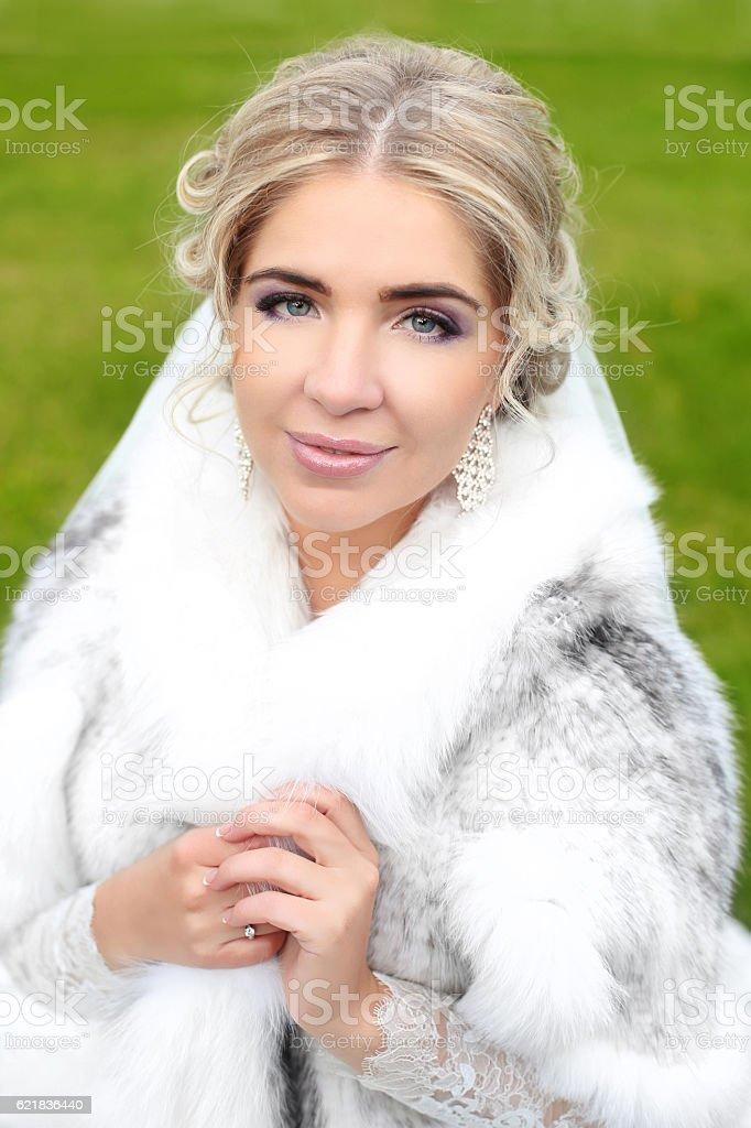 Beautiful smiling bride winter portrait. Attractive girl stock photo