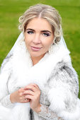 Beautiful smiling bride winter portrait. Attractive girl