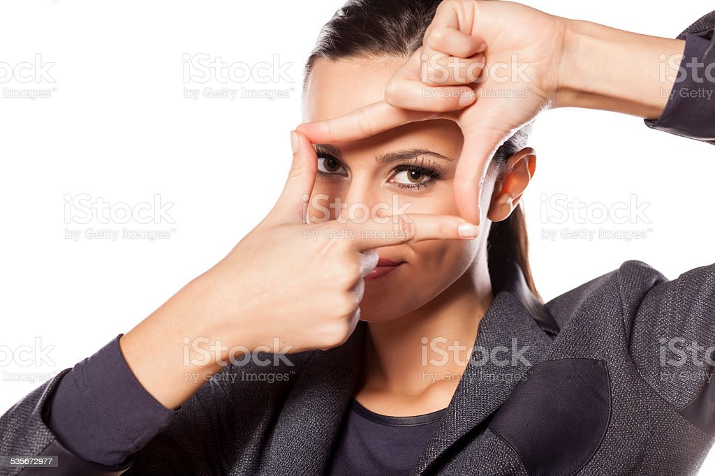 Beautiful smiling business woman making a frame with her fingers stock photo