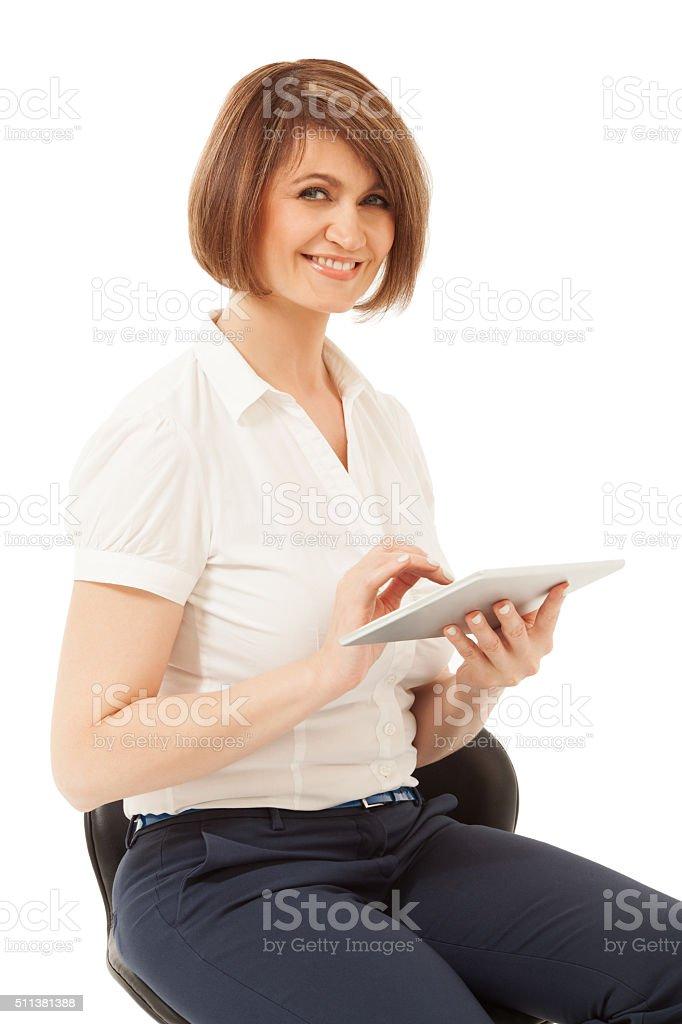 Beautiful smiling businesswoman holding pad stock photo