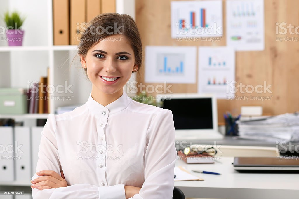 Beautiful smiling businesswoman standing in office stock photo