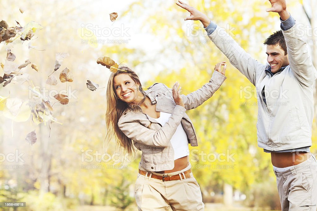 Beautiful smiling couple playing in the park. royalty-free stock photo