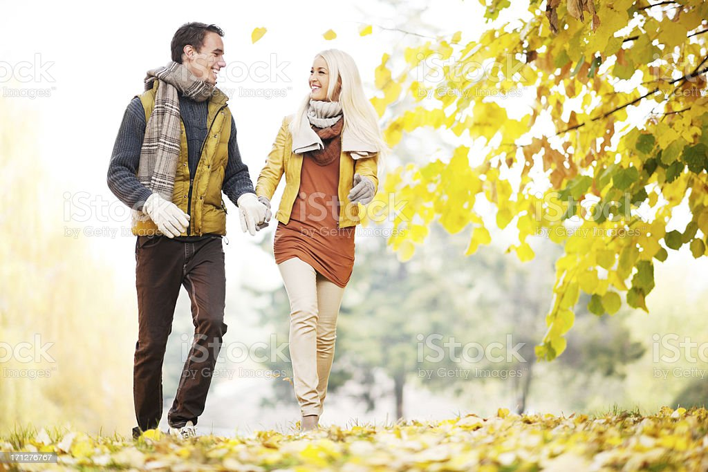 Beautiful smiling couple walking in the park. royalty-free stock photo