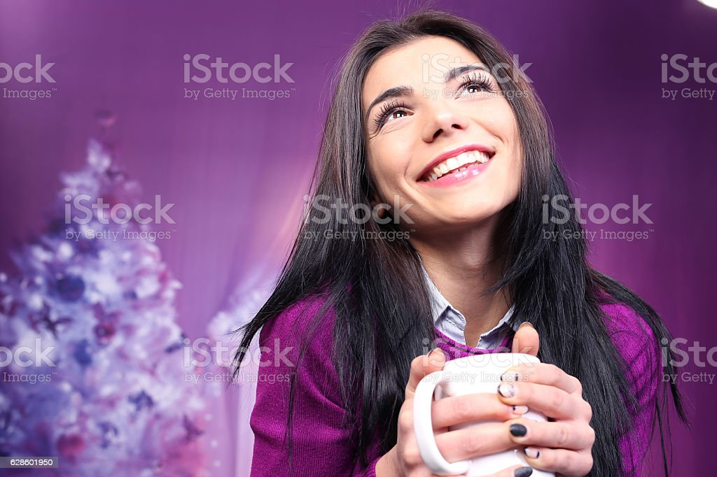 Beautiful smiling female against colorful background stock photo