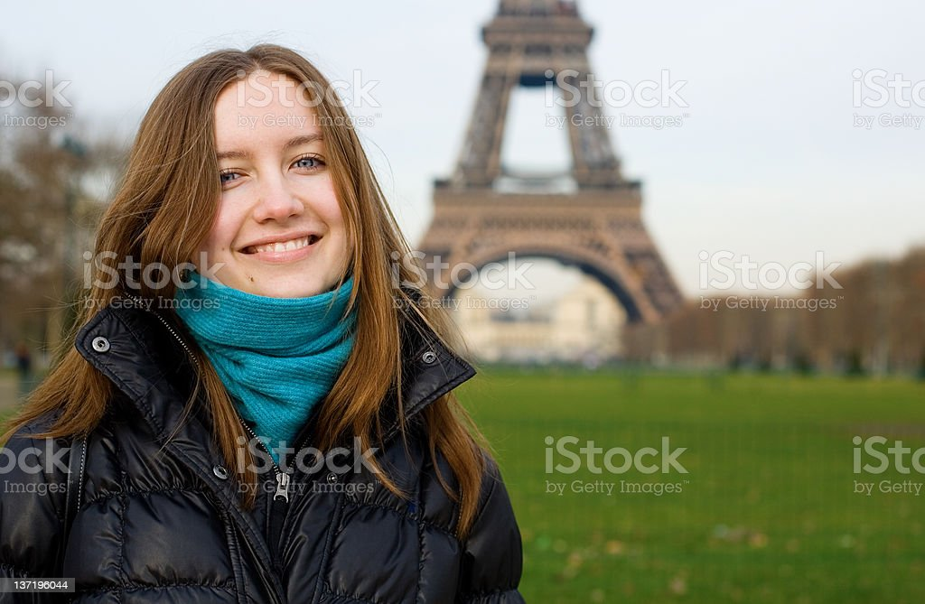 Beautiful smiling girl in Paris near the Eiffel Tower royalty-free stock photo