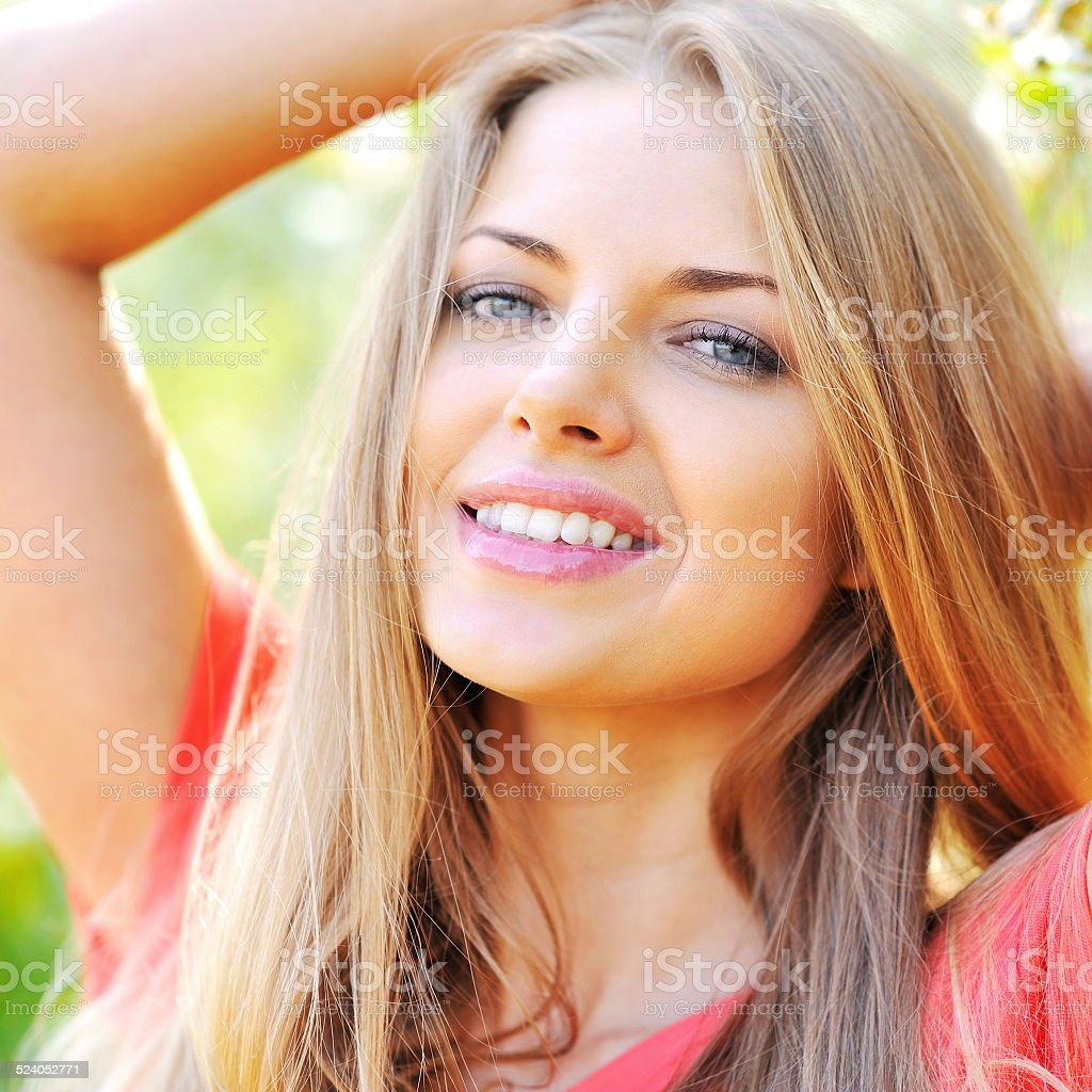 Beautiful smiling girl in spring garden - close up stock photo