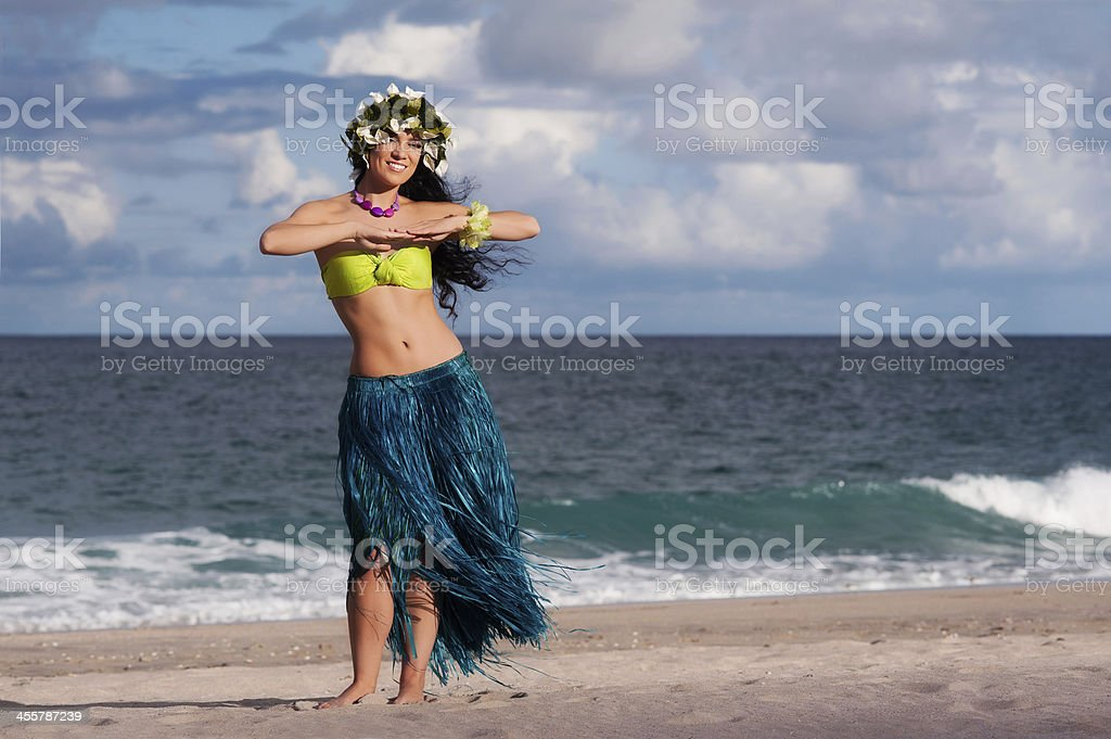 Beautiful, Smiling Hula Dancer on Beach stock photo