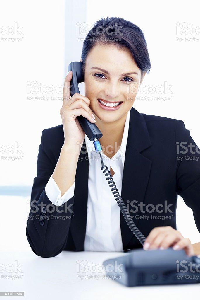 Beautiful smiling secretary talking on the telephone royalty-free stock photo