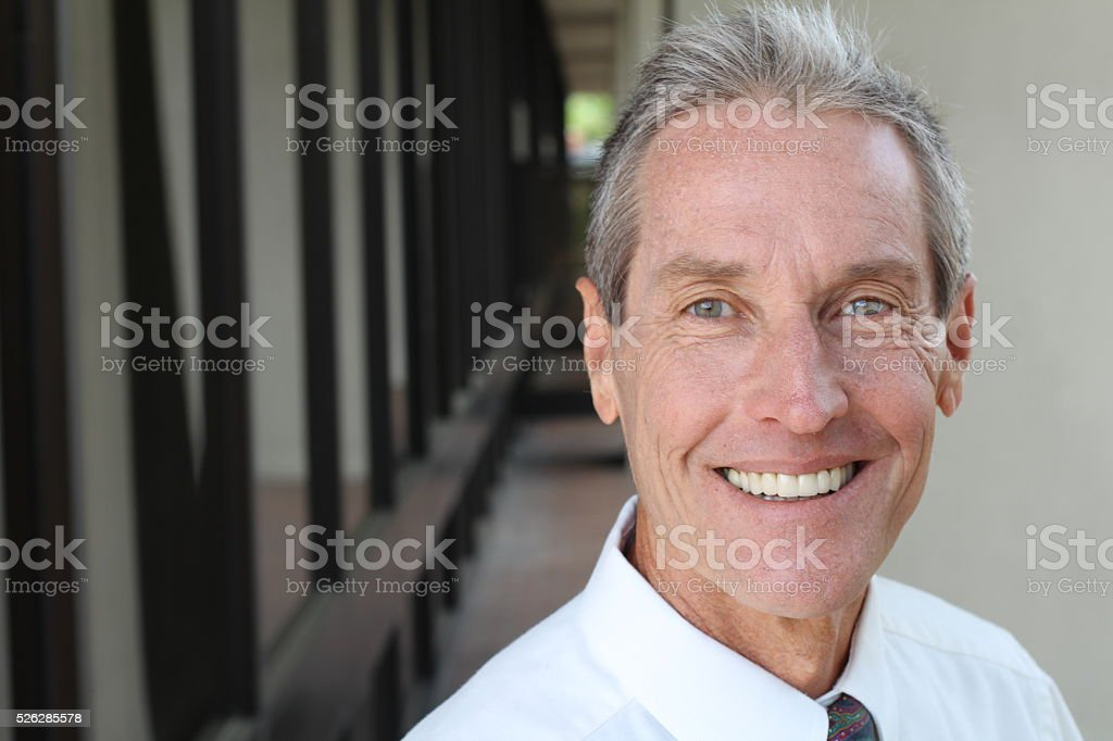 Beautiful Smiling Senior man Portrait close up. stock photo