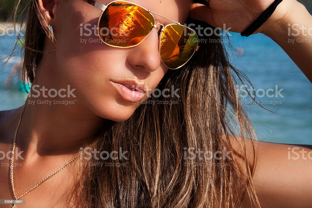 Beautiful smiling woman on beach stock photo