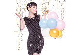 Beautiful, smiling woman playing with colorful balloons