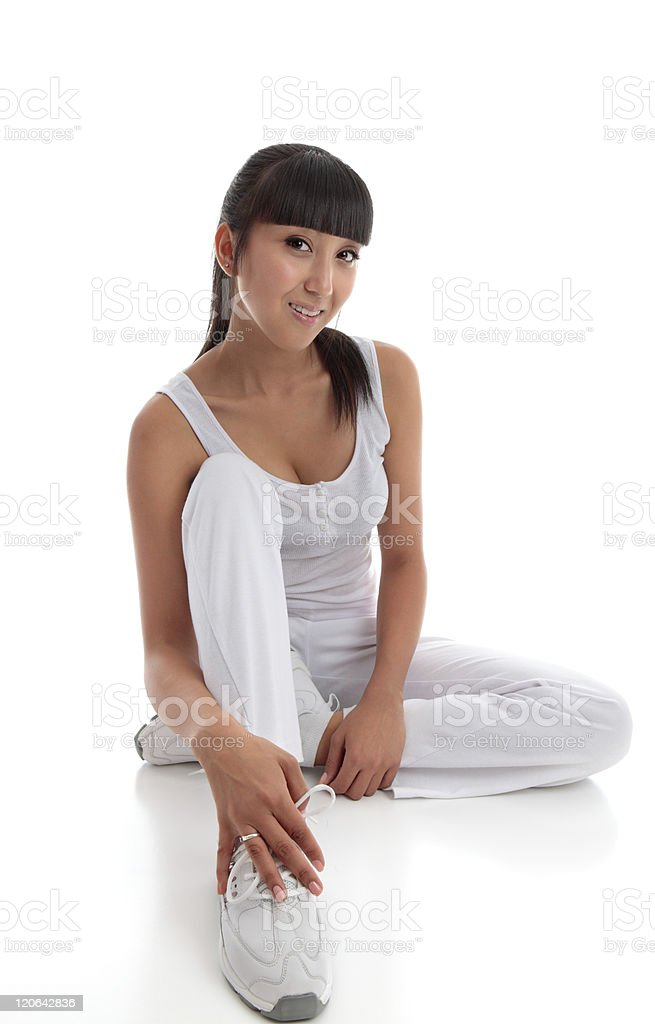 Beautiful smiling woman sitting on the floor royalty-free stock photo